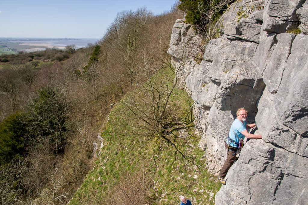 Les Ainsworth belayed by Dave Cronshaw on Yellow Edge, Warton Up